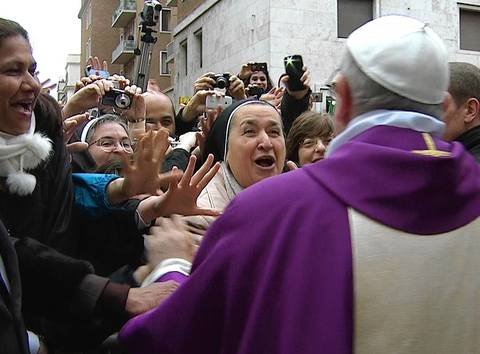 Newly elected Pope Francis greets crowds gathered in the Vatican, in this still image taken from video.