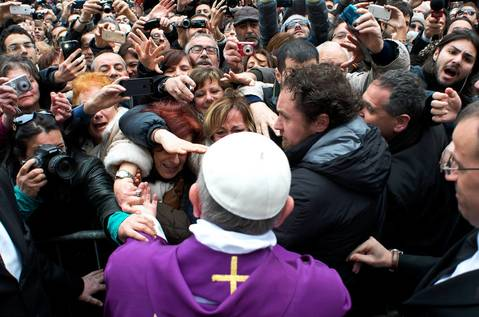 Pope Francis greets the crowds after conducting a mass in Saint Anna church inside the Vatican.