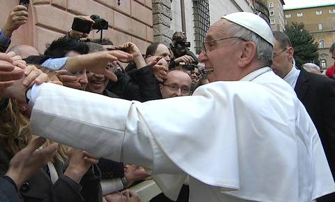Newly elected Pope Francis greets crowds gathered in the Vatican, in this still image taken from video. Pope Francis will appear at the window of his future private apartment to bless the faithful, gathered below, during the Sunday Angelus prayer.