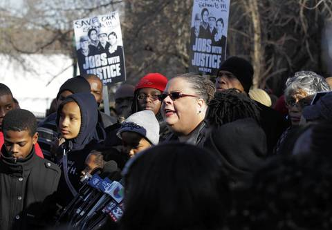 Chicago Teachers Union president speaks to the media outside Mahalia Jackson Elementary School on West 88th Street in Chicago. Jackson is one of the schools slated to be closed by CPS.