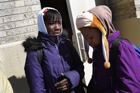 Daqueeta Holland, 10, left, who has been at Trumbull Elementary School since kindergarten, sobs as she laments with her best friend Dyanna Davis, 10, they will be separated next year in school. Students at Trumbull Elementary School at Ashland and Foster Avenues in Chicago were upset that their school has been announced as one of the 50 Chicago Public Schools to close.