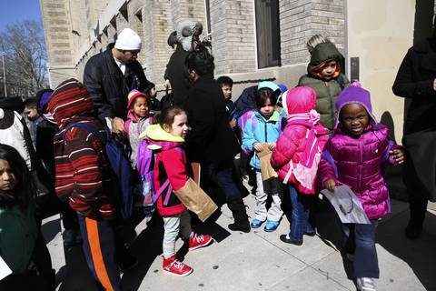 Students at Trumbull Elementary School at Ashland and Foster Avenues in Chicago leave at the end of the school day. It was announced that their school will be closed by CPS.