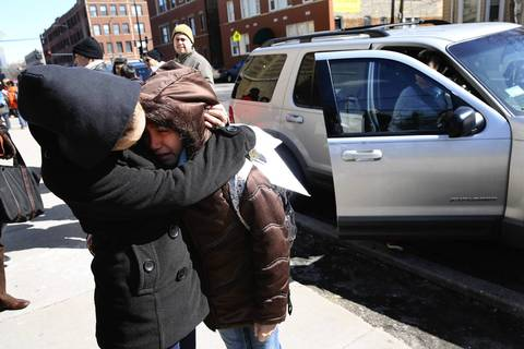 Katiria Paz comforts her daughter Myra, 10, who is crying as she leaves Trumbull Elementary School at Ashland and Foster Avenues in Chicago. She was upset that her school has been announced as one of the schools to be closed by CPS.