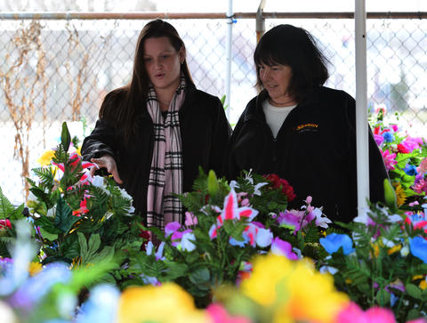 Amy Smith, of Nazareth (left) and her mother Donna Smith, of Bethlehem look at Easter cemetery flowers for Donna's late mother Elizabeth on Friday afternoon at Rich Mar Florist on 2407 Easton Avenue in Bethlehem. .