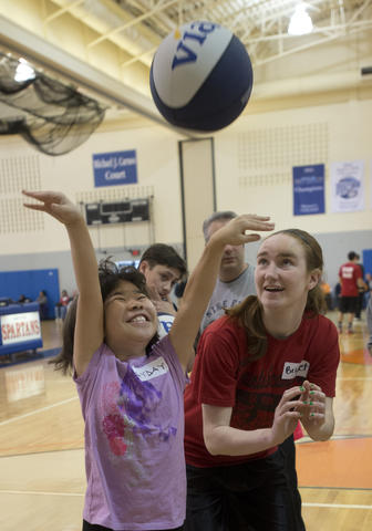Ayday Gerichten, 11, of Bethlehem, gets encouragement from Bethlehem Catholic senior basketball player Bridget Smith, 18, of Bethlehem, during the Via All-Star Basketball Clinic for special needs at Northampton Community College on Sunday. The clinic focused on the fundamentals of basketball with age specific  handling, passing, and shooting drills.