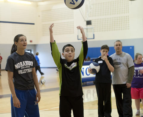 Pius X High School basketball player Jaclyn Smith, 18, of Bangor (left) helps David Weintraub, 12, of Bethlehem. during the Via All-Star Basketball Clinic for special needs at Northampton Community College on Sunday.
