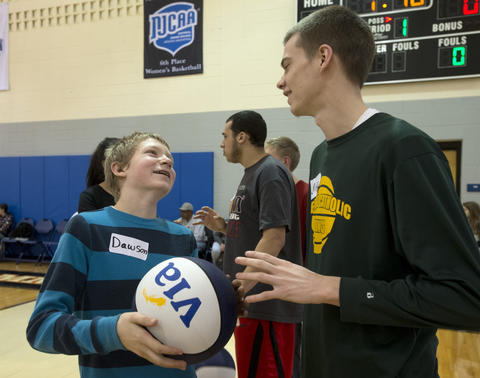 Dawson Bochini, 13, of Easton, looks up to Allentown Central Catholic High School senior basketball player Mike Kammerer , 18, of Allentown, during the Via All-Star Basketball Clinic for children with special needs at Northampton Community College on Sunday. The clinic focuses on the fundamentals of basketball with age specific  handling, passing, defense and shooting drills.  .///..Harry Fisher / THE MORNING CALL.MC-VIA-ALL-STAR-CLINIC..March 24, 2013...