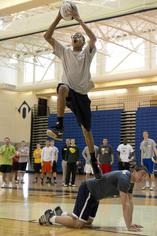 Theo Surratt, 17, of Bethlehem, tries to shoot a trick basket while leaping over the back of Northern Lehigh High School basketball player Caleb Johnson, 18, of Slatington, during the Via All-Star Basketball Clinic for special needs at Northampton Community College on Sunday. The clinic focused on the fundamentals of basketball with age specific handling, passing, and shooting drills.
