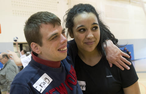 Craig Martin, 22, of Allentown, hugs Emmaus High School basketball player Maraya Bowen, 17, of Emmaus, during the Via All-Star Basketball Clinic for children with special needs at Northampton Community College on Sunday. The clinic focused on the fundamentals of basketball with age specific handling, passing, and shooting drills.