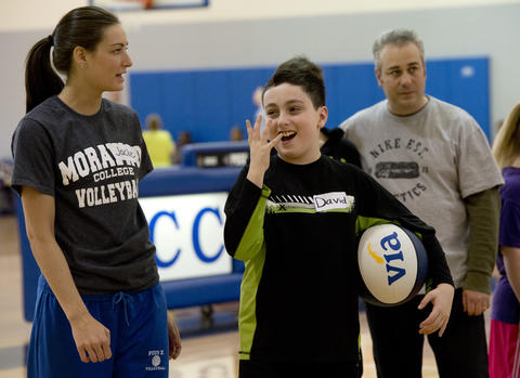 Pius X High School basketball player Jaclyn Smith, 18, of Bangor (left) helps David Weintraub, 12, of Bethlehem, during the Via All-Star Basketball Clinic for children with special needs at Northampton Community College on Sunday. The clinic focused on the fundamentals of basketball with age specific  handling, passing, and shooting drills.