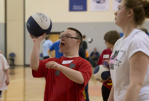Zach Eisel, 19, of Easton,aims for the hoop during the Via All-Star Basketball Clinic forspecial needs at Northampton Community College on Sunday. The clinic focused on the fundamentals of basketball with age specific  handling, passing, and shooting drills.
