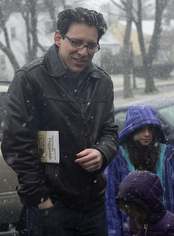 "Hartley Lachter of Allentown ( left) watches as his ""chametz - or leavened food products is burned in the rear of Congregation Sons of Israel on Monday's snowy morning. The ritual, which dates to biblical times, is based on the obligation that all Jews have to rid themselves of chametz by the morning before Passover each year. This year, Passover falls at the earliest date since 1899. For Jews worldwide, Passover is the commemoration of liberation by God, over 3,300 years ago from slavery in Egypt during the time of the Pharaohs. It also celebrates the birth of the Jewish nation under the leadership of Moses. Passover commences on the 15th of the Hebrew month of Nisan and lasts for 8 days (7 in Israel)"