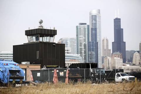 The unused Meigs Field tower remains on the Chicago Park District's Northerly Island ten years after the airport was closed. The area around the tower is used to store Park District equipment and supplies.