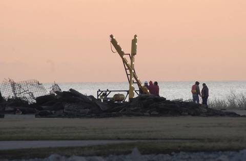 "Working overnight, construction crews used backhoes to tear up large sections of the runway at Meigs Field, effectively shutting down the lakefront airport. An illuminated ""X"" stands at the south end of the runway warning pilots the field is closed. Another ""X"" was placed on the north end."