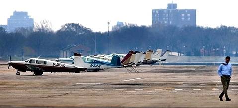 Planes sit stranded at Meigs Field as city officials and the FAA decide when and if the planes can safely depart by air, or whether they will be towed at city expense. The runway at the airport was dug up without advanced notice by the city to stem a concerned security risk.