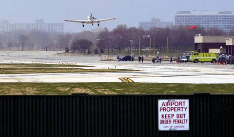 The last stranded airplane, owned by Dr. Ken Selke of suburban St. Louis, flies out of Meigs Field in Chicago a little after 7 a.m. Saturday morning. Airport employees fired off about a half dozen smoke flares due to the gusting winds before the Beechcraft A36 Bonanza headed north marking the end for the closed airport. Mayor Richard M. Daley plans to turn Meigs Field into a park.