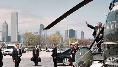 President George W. Bush waves goodbye as he boards the Marine One helicopter at Meigs Field enroute to O'Hare Airport where he boarded Air Force One for the ride back to Washington, D.C.