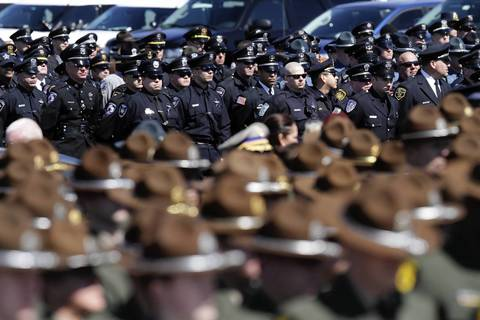 Law enforcement officers stand in solidarity with the the Illinois State Police to honor 28-year-old Trooper James Sauter at his funeral ceremony at Moraine Valley Church in Palos Heights, Ill. Sauter was killed Thursday when a semitrailer hit his squad car on I-294 in Glenview.