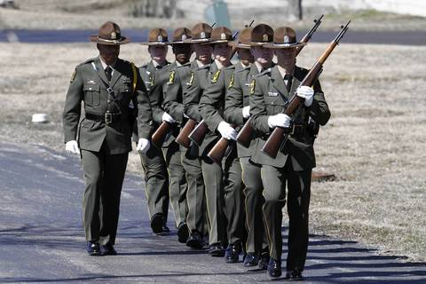 The Illinois State Police honor guard arrives at 28-year-old Trooper James Sauter's funeral ceremony at Moraine Valley Church in Palos Heights, Ill. Sauter was killed Thursday when a semitrailer hit his squad car on I-294 in Glenview.
