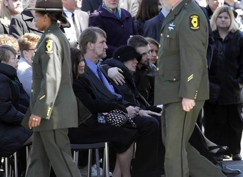 The family of Illinois State Police Trooper James Sauter comfort each other at his funeral ceremony at Moraine Valley Church in Palos Heights, Ill. Sauter was killed Thursday when a semitrailer hit his squad car on I-294 in Glenview.