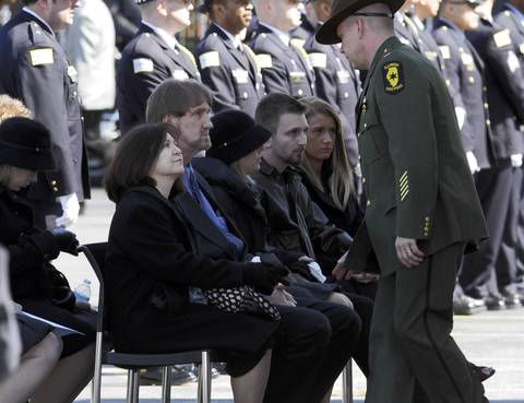 The family of Illinois State Police Trooper James Sauter attends his funeral ceremony at Moraine Valley Church in Palos Heights, Ill.