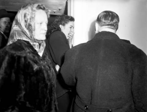 Grace Rinearson, 19, center, weeps after identifying the body of her younger sister Roberta Rinearson, 10, who was murdered on Dec. 17, 1948. Roberta's body was found beaten and strangled in a ditch on County Line Road, northeast of Elmhurst.