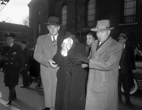 Eleanor Rinearson, mother of murdered 10-year-old Roberta Rinearson, is helped by friends at the funeral for her daughter on Dec. 22, 1948. Roberta, who was living with her maternal grandmother and two sisters at the time of her death, had not seen her mother for several years and thought she was dead.
