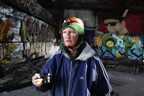 """Gloria Cassens lives in the Marshall Hotel and explores Chicago everyday with her cell phone camera and a """"point and shoot"""" camera taking photos of whatever she sees, but concentrating on """"people in distress."""" On the day this photograph was made by Tribune staff photographer Nancy Stone, she toured one of her favorite places, a massive old abandoned industrial site on the South Side."""