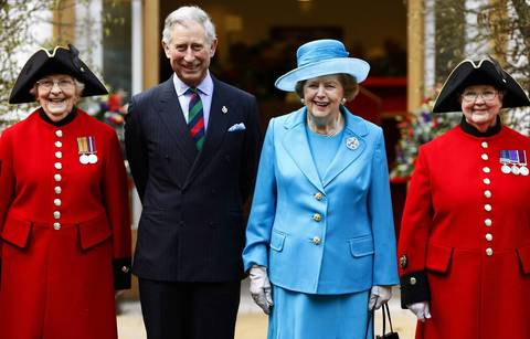 Britain's Prince Charles (2nd L) and former Prime Minister Margaret Thatcher (2nd R) pose with Chelsea pensioners Dorothy Hughes (L) and Winifred Phillips in 2009 as they attend the opening of a new infirmary at the Royal Hospital Chelsea in London.