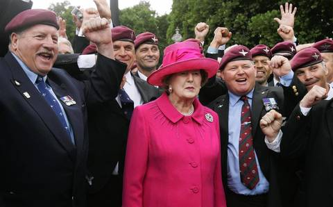 Former British Prime Minister Margaret Thatcher (C) and Falklands veterans take part in a march in London in 2007, during a service to commemorate the 25th anniversary of the Falkland Islands conflict.