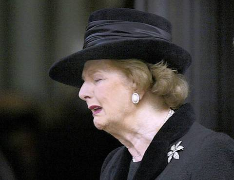 Britain's former Prime Minister Margaret Thatcher cries as she leaves a service of remembrance in 2003 for her husband Sir Denis Thatcher who died earlier in the year.