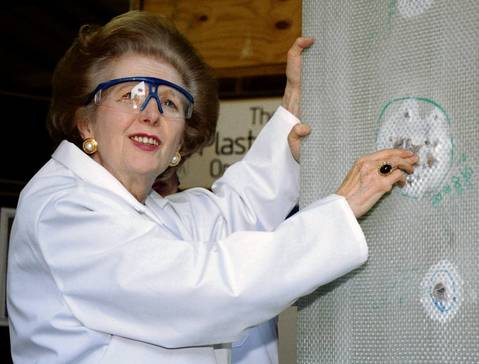 Baroness Thatcher examines a sheet of bullet-proof material in 1997 during a visit to a factory producing ballistic and blast protection products.