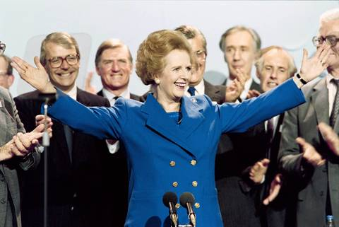 British Prime Minister Margaret Thatcher acknowledges applause in 1989 at the end of the Conservative Party conference in Blackpool.