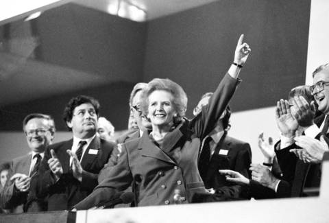 British Prime Minister Margaret Thatcher points skyward as she receives standing ovation at Conservative Party Conference in 1989.