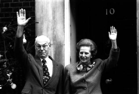 British Prime Minister Margaret Thatcher and husband Denis Thatcher wave to a crowd outside her residence at 10 Downing Street, London.