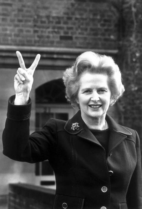 Conservative Party leader Margaret Thatcher signals 'victory' outside her home in Chelsea, London in 1976.