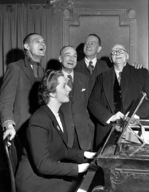 Conservative candidate Margaret Roberts accompanies four voters on the piano in a sing-song in 1950 after a brief political argument in the bar of The Bull Inn, Dartford. Roberts married Denis Thatcher and went on to become Prime Minister.