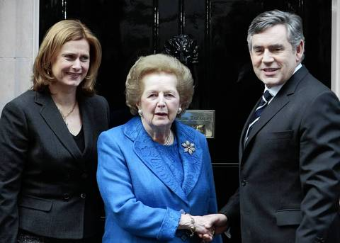 British Prime Minister Margaret Thatcher poses for a photograph with Prime Minister Gordon Brown and his wife Sarah in 2009 outside 10, Downing Street in London following a meeting to unveil a specially commissioned portrait of Thatcher.