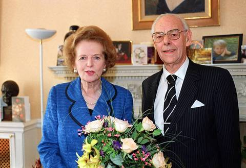 Former British Prime Minister Margaret Thatcher and her husband Denis pose for birthday pictures in London in 2003. Denis died later this year.