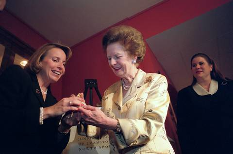 Karen Miller, of the Evanston-North Shore Junior League, left, presents former British Prime Minister Margaret Thatcher an enamel box of Northwestern University at Northwestern's Cahn Auditorium. The former Prime Minister discussed terrorism during her speech.