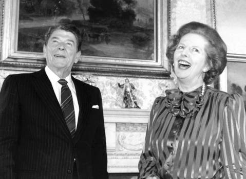 British Prime Minister Margaret Thatcher shares a laugh with President Ronald Reagan.