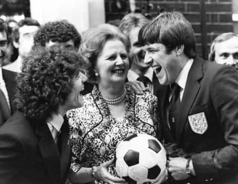 Emlyn Hughes and Kevin Keegan, members of the England Football Squad enjoying a joke with Mrs Margaret Thatcher outside No 10 Downing Street.