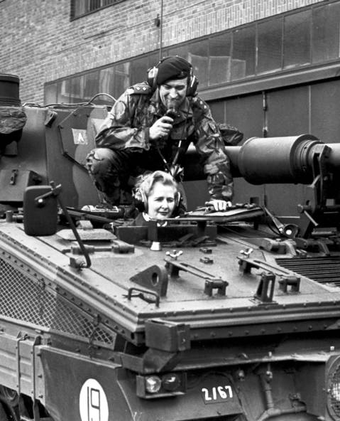 Margaret Thatcher, then chairwoman of the British Conservative Party, and Lieutnant Parradine, sit on a tank of the 7th regiment of the Royal Signals in Herford, western Germany.
