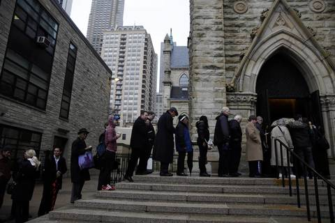 About 100 people wait in line outside Holy Name Cathedral in Chicago for Roger Ebert's funeral.