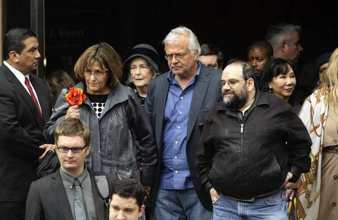 Steve Dahl, center, leaves Roger Ebert's funeral at Holy Name Cathedral on Monday.