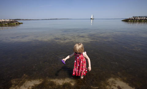 Three-year-old Cadence Todd plays at the Yorktown waterfront on Tuesday afternoon.