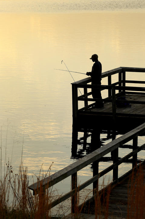 Joe Daughety of Williamsburg takes advantage of the mild weather to get in some fishing at Newport News Park Friday evening. The weather is expected to be warm and mild all weekend.