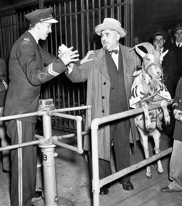 An usher stops William Sianis, owner of the Billy Goat Tavern, from entering the ball park Oct. 12, 1945. Sianis crashed the gate but could not seat the goat.