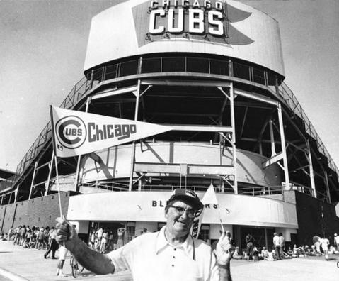 Concessionaire Emile Bougie stood at the corner of Waveland and Sheffield avenues selling pennants, hoping to take advantage of growing crowds coming out to see the then first-place Cubs in June of 1977.