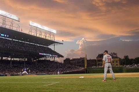 Cubs pitcher Matt Clement on the mound with clouds hovering over Wrigley in a 2004 game with the Cardinals.